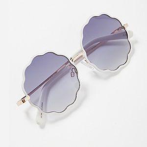 Wavy round sunglasses
